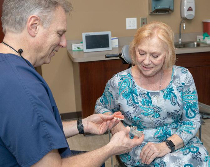 dr-hamlin-discussing-implant-supported-dentures-procedure