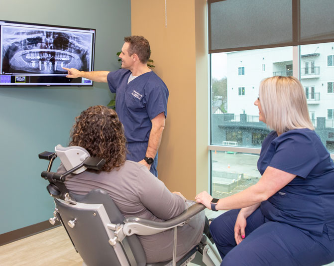 dr-wells-discussing-full-arch-dental-implants-1