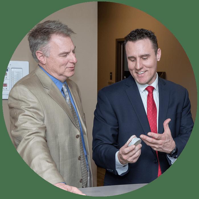 oral-surgeons-discussing-dental-procedure